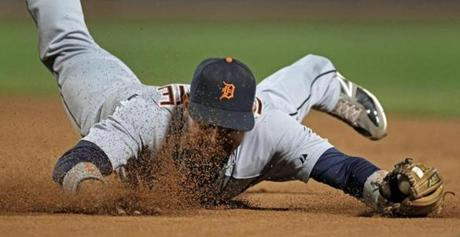 Tigers second baseman Omar Infante got a face full of dirt, but he made a great diving stop of a ball hit by the Red Sox' Ryan Sweeney. July 30, 2012.