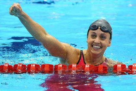 LONDON, ENGLAND - AUGUST 02: Rebecca Soni of the United States celebrates after setting a new world record time of 2:19.59 in the Women's 200m Breaststroke Final on Day 6 of the London 2012 Olympic Games at the Aquatics Centre on August 2, 2012 in London, England. (Photo by Al Bello/Getty Images)