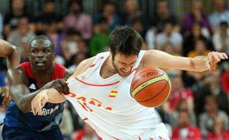 Fernando San Emeterio #11 of Spain lost control of the ball against Luol Deng #9 of Great Britain in the first half during the men's basketball preliminary round match.