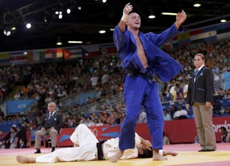 Czech Republic's Lukas Krpalek celebrated after defeating Japan's Takamasa Anai (white) in their men's -100kg elimination round of 16 judo match.