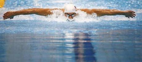 Michael Phelps swam to a first place finish in heat 6 of the men's 100-meter butterfly event.