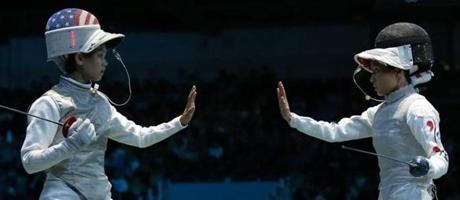 Lee Kiefer of the United States and South Korea's Hyun Hee Nam, right, saluted at the start of their women's foil team quarterfinals fencing match.