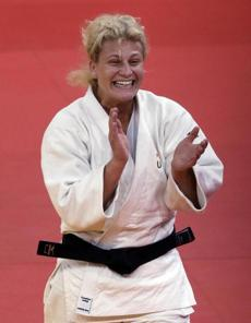 Kayla Harrison of the United States celebrated after winning her match against Gemma Gibbons of Great Britain for the gold medal during the women's 78-kg judo competition.