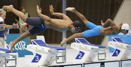 Sofyan El-Gadi of Libya, left, and Bahrain's Khalid Alibaba started in a men's 100-meter butterfly swimming heat.