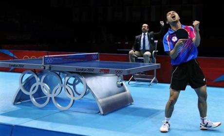Chuang Chih-yuan of Taiwan reacted against Dimitrij Ovtcharov of Germany during the bronze medal match at men's singles table tennis.