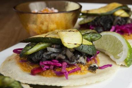 Vegetarian tacos with roast zucchini, asparagus, huitlacoche, and pickled cabbage.