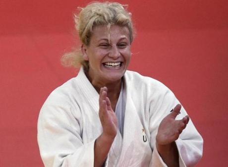 Kayla Harrison cried on the podium after her victory Thursday. The win resounded with friends in Massachusetts.