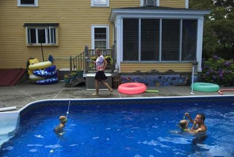The Woods played with their children in their parents' backyard in-ground pool.