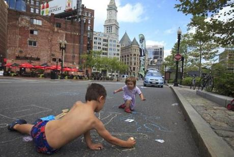Boston, MA - 8/05/2012 - Abigail Warren, cq, 2, and her brother Benjamin Warren, cq, of Stoneham, scrawled with chalk on John F. Fitzgerald Surface Road during the