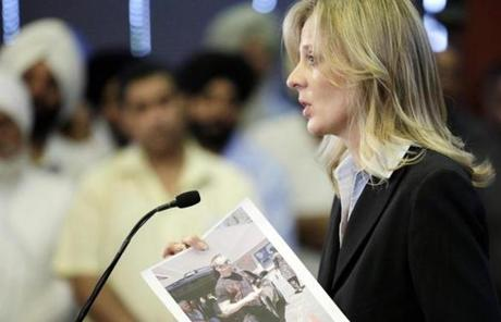 Teresa Carlson of the FBI held up a photo of the suspected gunman at a press conference in Oak Creek, Wisc.