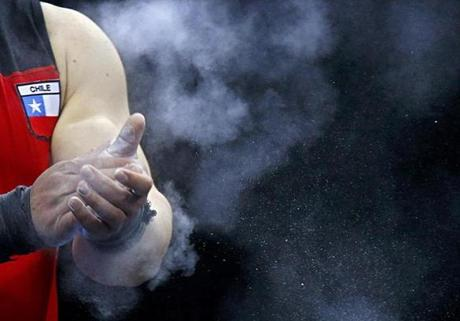 Chile's Jorge Garcia Bustos applies chalk on his hands during the men's 105kg Group B clean and jerk weightlifting competition at the ExCel venue during the London 2012 Olympic Games August 6, 2012. REUTERS/Dominic Ebenbichler (BRITAIN - Tags: OLYMPICS SPORT WEIGHTLIFTING)