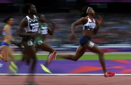 Britain's Margaret Adeoye (R) runs ahead of Allison Peter of the U.S. Virgin Islands in the women's 200m round 1 heat at the London 2012 Olympic Games at the Olympic Stadium August 6, 2012. REUTERS/Eddie Keogh (BRITAIN - Tags: SPORT OLYMPICS SPORT ATHLETICS)