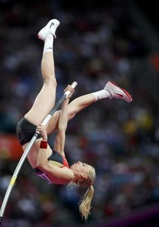 Germany's Lisa Ryzih competes during the women's pole vault final at the London 2012 Olympic Games at the Olympic Stadium August 6, 2012. REUTERS/Mark Blinch (BRITAIN - Tags: OLYMPICS SPORT ATHLETICS)