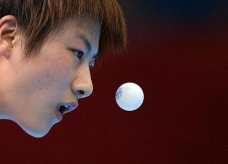 China's Ding Ning eyes the ball as she competes against South Korea's Kim Kyungah in the Women's Semifinal between China and South Korea of the London 2012 Olympic Games in London on August 6, 2012. AFP PHOTO / SAEED KHANSAEED KHAN/AFP/GettyImages