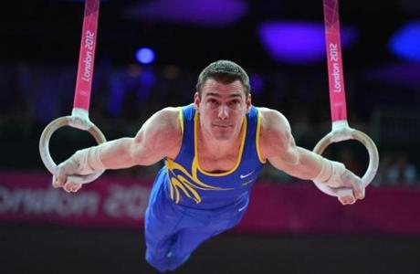 Brazil's gymnast Arthur Nabarrete Zanetti performs to win gold in the men's rings final of the artistic gymnastics event of the London Olympic Games on August 6, 2012 at the 02 North Greenwich Arena in London. AFP PHOTO / BEN STANSALLBEN STANSALL/AFP/GettyImages