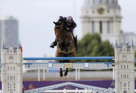 Peter Charles, of Great Britain, rides Vindicat, during the equestrian show jumping team competition at the 2012 Summer Olympics, Monday, Aug. 6, 2012, in London. (AP Photo/David Goldman)