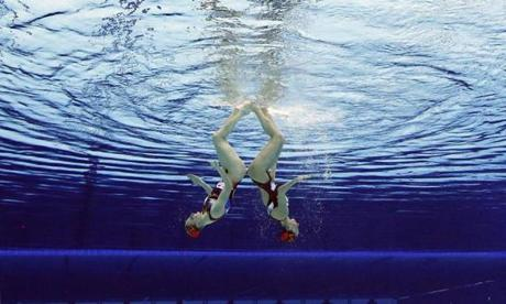Natalia Ischenko and Svetlana Romanshina of Russia compete during women's duet synchronized swimming preliminary round at the Aquatics Centre in the Olympic Park during the 2012 Summer Olympics in London, Monday, Aug. 6, 2012. (AP Photo/Mark J. Terrill)