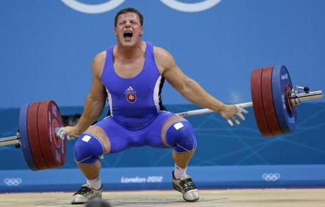 Martin Tesovic of Slovakia competes during the men's 100-kg weightlifting competition at the 2012 Summer Olympics, Monday, Aug. 6, 2012, in London. (AP Photo/Ng Han Guan)