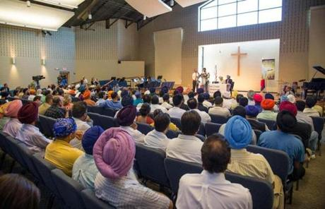 Members of the Sikh community gather at Oak Creek Centennial Church for a press conference.