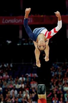 LONDON, ENGLAND - AUGUST 07: Alexandra Raisman of the United States competes on the beam during the Artistic Gymnastics Women's Beam final on Day 11 of the London 2012 Olympic Games at North Greenwich Arena on August 7, 2012 in London, England. (Photo by Ronald Martinez/Getty Images)