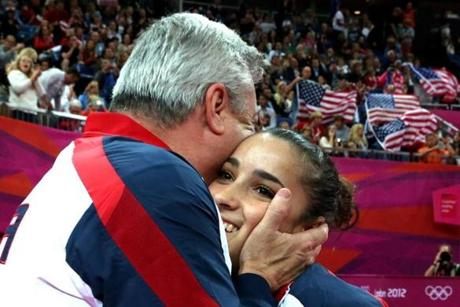 LONDON, ENGLAND - AUGUST 07: Alexandra Raisman of the United States hugs coach Mihai Brestyan after winning the gold medal for the Artistic Gymnastics Women's Floor Exercise final on Day 11 of the London 2012 Olympic Games at North Greenwich Arena on August 7, 2012 in London, England. (Photo by Ronald Martinez/Getty Images)