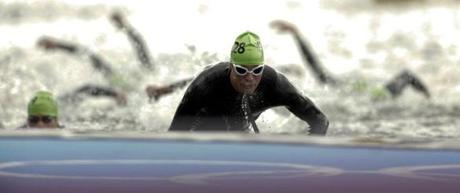 Belgium's Simon De Cuyper competes in the men's triathlon final during the London 2012 Olympic Games at Hyde Park August 7, 2012. REUTERS/Tim Wimborne (BRITAIN - Tags: OLYMPICS SPORT TRIATHLON TPX IMAGES OF THE DAY)