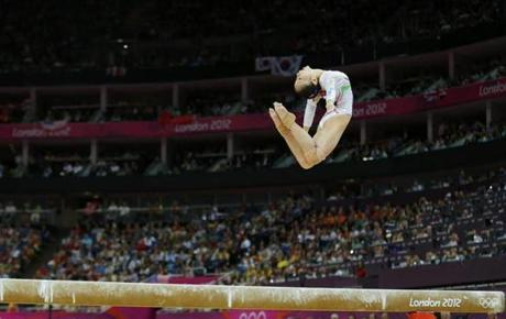 China's Deng Linlin competes in the women's gymnastics balance beam final in the North Greenwich Arena during the London 2012 Olympic Games August 7, 2012. REUTERS/Mike Blake (BRITAIN - Tags: SPORT OLYMPICS SPORT GYMNASTICS TPX IMAGES OF THE DAY)