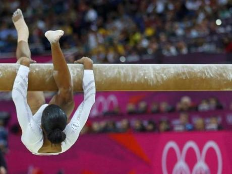 Gabrielle Douglas of the U.S. falls as she competes in the women's gymnastics balance beam final in the North Greenwich Arena during the London 2012 Olympic Games August 7, 2012. REUTERS/Mike Blake (BRITAIN - Tags: OLYMPICS SPORT GYMNASTICS TPX IMAGES OF THE DAY)