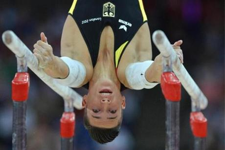 Germany's gymnast Marcel Nguyen performs to win silver in the men's parallel bars competition of the artistic gymnastics event of the London Olympic Games on August 7, 2012 at the 02 North Greenwich Arena in London. AFP PHOTO / BEN STANSALLBEN STANSALL/AFP/GettyImages