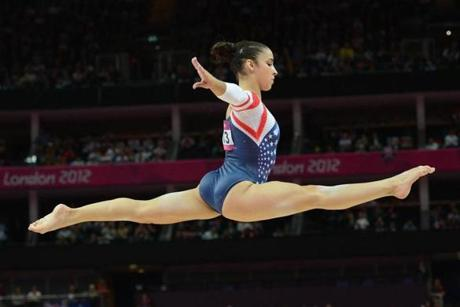 US gymnast Alexandra Raisman performs during the women's beam competition of the artistic gymnastics event of the London Olympic Games on August 7, 2012 at the 02 North Greenwich Arena in London. China's Deng Linlin won gold while Sui Lu won the silver medal, with Alexandra Raisman of the United States taking the bronze medal. AFP PHOTO / EMMANUEL DUNANDEMMANUEL DUNAND/AFP/GettyImages