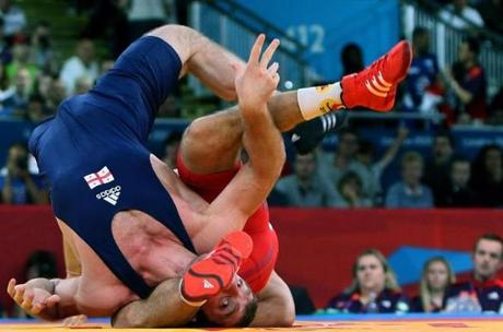 Hungary's Tamas Lorincz (back) wrestles Georgia's Manucher Tskhadaia during their 96 kg Greco Roman Wrestling semi-final match of the London 2012 Olympic Games at the Excel Centre in London on August 7, 2012.MARWAN NAAMANI/AFP/GettyImages