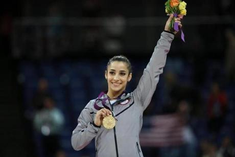 Gold medalist US gymnast Alexandra Raisman poses on the podium of the women' s floor exercise of the artistic gymnastics event of the London Olympic Games on August 7, 2012 at the 02 North Greenwich Arena in London. AFP PHOTO / THOMAS COEXTHOMAS COEX/AFP/GettyImages