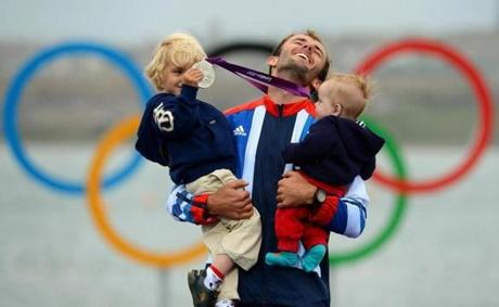 Britain's Nick Dempsey (C) poses with his sons Thomas-Flynn (L) and Oscar (R) after he won silver in the men's RS:X sailing class at the London 2012 Olympic Games, in Weymouth on August 7, 2012. AFP PHOTO/William WESTWILLIAM WEST/AFP/GettyImages