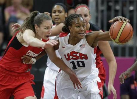 Canada's Kim Smith, left, and USA's Tamika Catchings (10) chase a loose ball during a quarterfinal women's basketball game at the 2012 Summer Olympics, Tuesday, Aug. 7, 2012, in London. (AP Photo/Eric Gay)