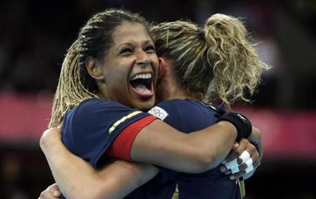 Spain's Marta Mangue Gonzalez, left, embraces team mate Spain's Begona Fernandez Molinos after defeating Croatia in their women's handball quarterfinal match at the 2012 Summer Olympics, Tuesday, Aug. 7, 2012, in London. (AP Photo/Matthias Schrader)
