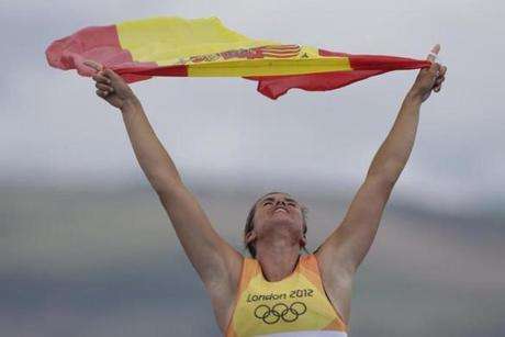 Spain's Marina Alabau celebrates after winning the rs:x women gold medal at the London 2012 Summer Olympics, Tuesday, Aug. 7, 2012, in Weymouth and Portland, England. (AP Photo/Bernat Armangue)