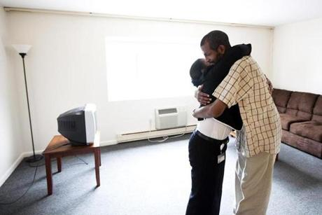 Susan Young and Antonio Walker embraced as she leaves him in his new apartment after helping him go grocery shopping. Walker had been homeless until Young helped him find a place to live.