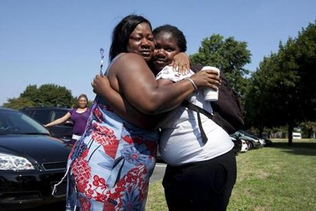 A tearful Theresa Johnson, left, hugged her daughter Jalanae as she returns from Crossroads for Kids camp on Aug 2.