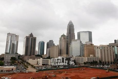 The Bank of America building rises above the Charlotte skyline.