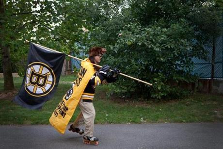 Devlin rollerbladed in a park near his home decked out in his Boston Bruins gear.