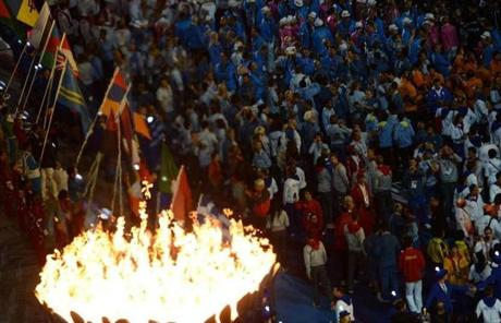 Athletes gathered near the Olympic flame at the closing.