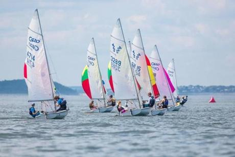 420-class sailboats race across Ipswich Bay on Monday.