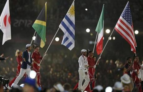 Bryshon Nellum, in front, held the US flag as athletes entered during the show.