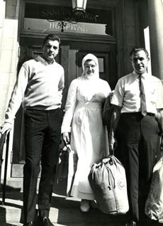 August 24 1967:  Conigliaro was escorted from Sancta Maria Hospital in Cambridge by Sister Mary Leonard and was driven to his Swampscott home by his father Sal (right.) The young Sox slugger completely absolved Angels pitcher Jack Hamilton, whose fastball hit Tony flush in the face and fractured his cheekbone.