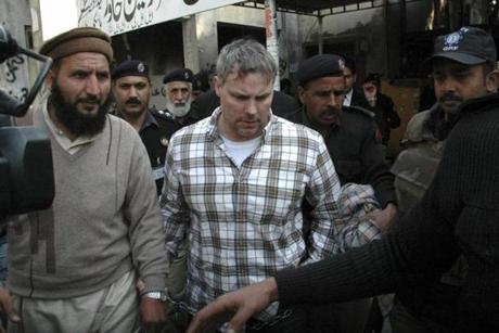 Raymond Allen Davis is escorted by Pakistani security officials.