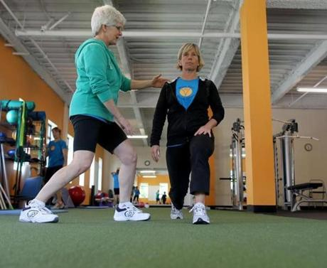 Moria Lanier (left) guides Becky Proskauer during a session at Greatest Age Fitness.