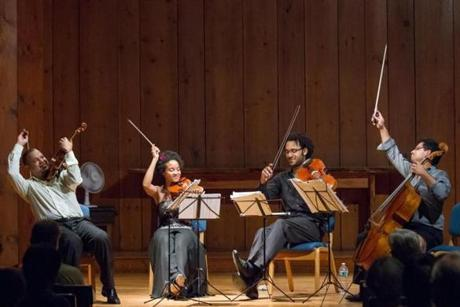 Members of the Harlem Quartet with temporary cellist Ismar Gomes (left,) finished a concert at Tannery Pond in New Lebanon, NY on  August 4, 2012.