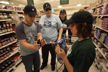 "Nemanja Djurdjevic ""read"" Kristin Turgeon's box with a smartphone during the Carroll Center for the Blind ""app camp'' outing. Brian Charlson and Cailin Currie observed."