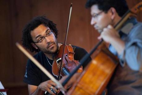 The Harlem Quartet's temporary cellist Ismar Gomes and violist Juan Miguel Hernandez rehearsed before a concert at Tannery Pond in New Lebanon, NY on August, 2012.