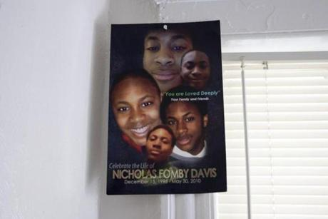 A poster collage of Nicholas Fomby-Davis hangs in his old music room at his family's Norton Street home. Nicholas enjoyed playing drums and his PlayStation.